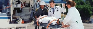 emergency physicians with patient at helicopter