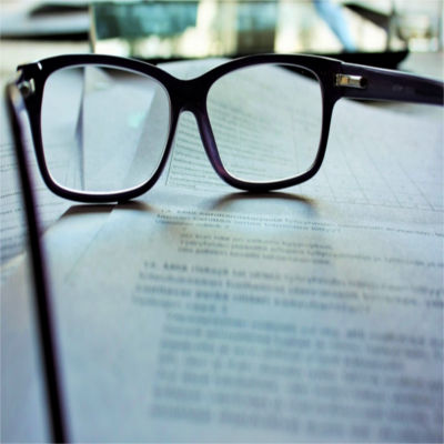 A pair of aeading glasses resting on a book
