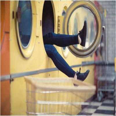 A person inside a public washing machine