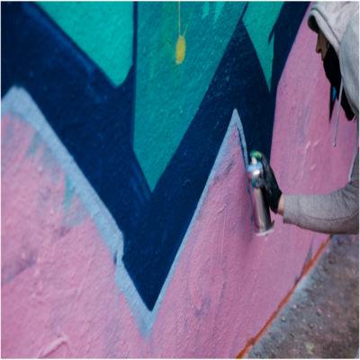 A person spray-painting graffiti