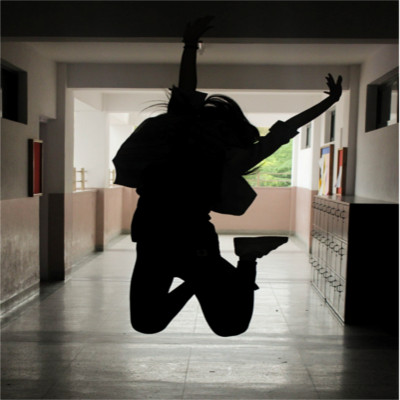 A person jumping in a school hallway