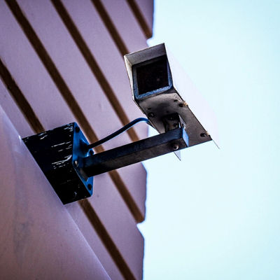 A security camera on a building.