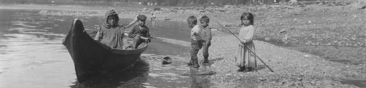 Tlingit Indian children playing with a toy canoe in Taku Harbor south of Juneau, Alaska, May 25, 1905. Edward M. Kindle Collection, U.S. Geological Survey.