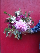 A stunning wedding bouquet with a dinner plate dahlia, gold eucalyptus, ferns, myrtle, waxflower and spray roses | Designed by Natasha Price of alaskaknitnat.com