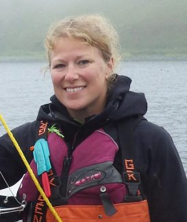 Melissa Good in fishing gear smiling