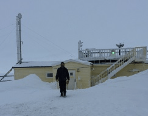 NOAA scientist Bryan Thomas stands outside the Barrow Atmospheric Baseline Observatory.