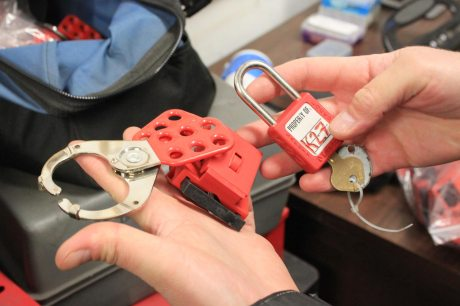 Close up of lock, key and other lockout-tagout devices