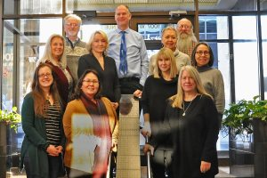 Eleven members of the Alaska Sea Grant advisory committee