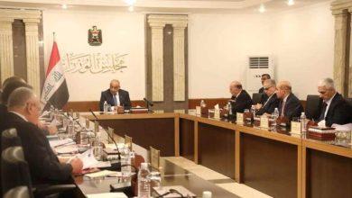 صورة بين جريمة المطار واستقالة حكومة عادل عبد المهدي