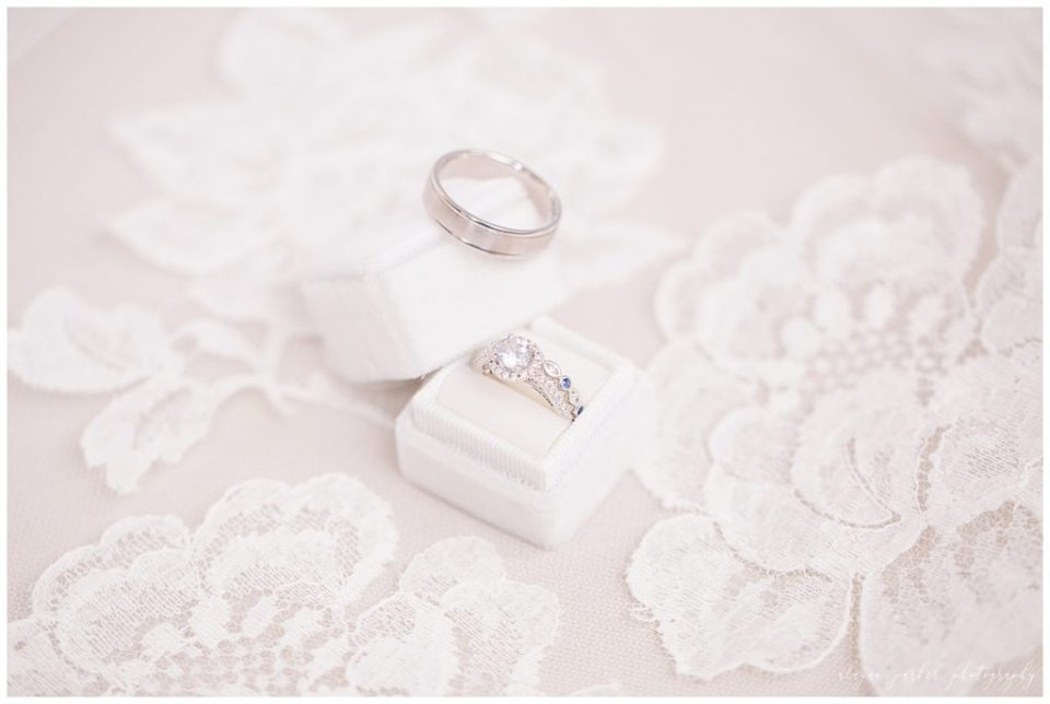 A photograph up close of the wedding rings resting on the lace of the bride's gown at the Station 67 wedding venue by Alayna Parker  - Columbus OH wedding photography