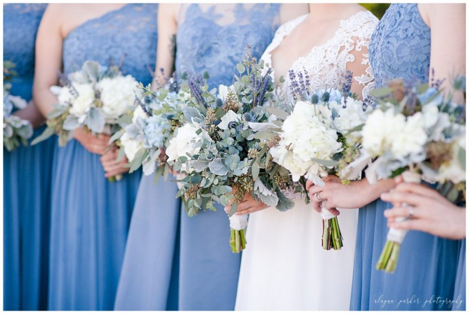 A picture of a closeup of the beautiful wedding bouquets held by the bride and bridesmaids at the Station 67 wedding venue by Alayna Parker  - Columbus  wedding photographers