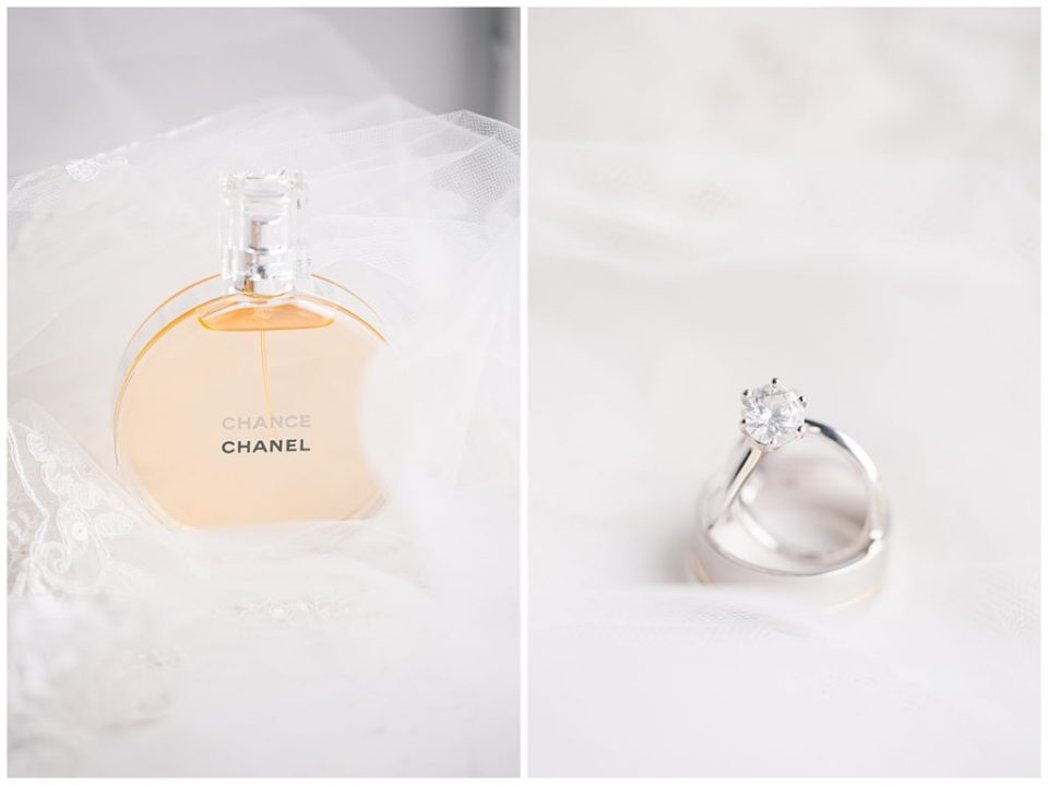 A photograph of the bride's perfume, and a closeup view of the bride and groom's wedding rings at the Hotel LeVeque in Downtown Columbus by Alayna Parker  - Columbus OH wedding photography