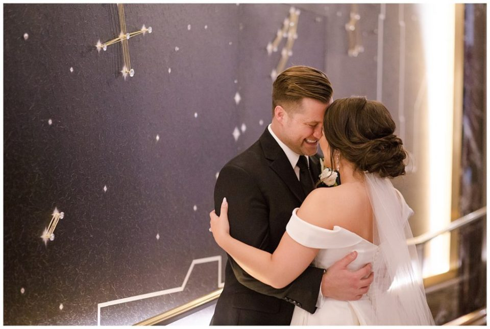 A picture of the bride and groom holding each other close as they smile happily together at a Hotel LeVeque wedding by Alayna Parker Photography  - Columbus  marriage photography