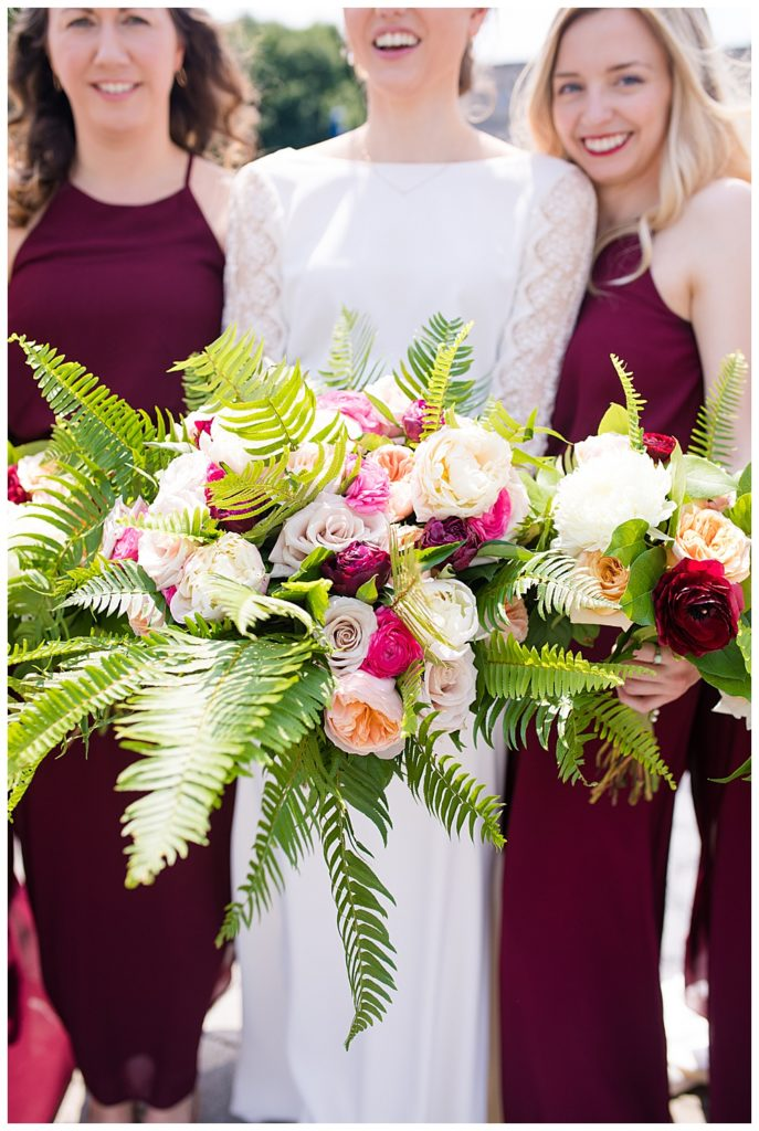 bridal bouquet with pink, white, and peach flowers, and fern leaves