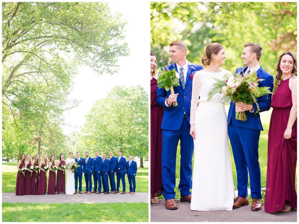 bridal party standing in front of tall trees at schiller park