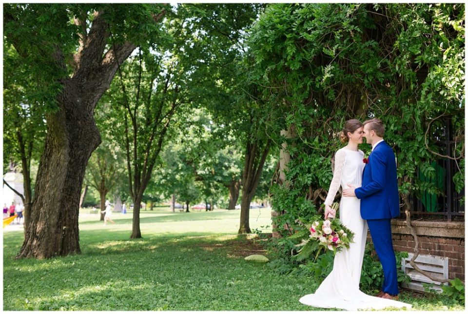 A picture of a bride and groom standing close together in a beautiful outdoor setting, surrounded by trees at Dock 580 wedding venue  by Alayna Parker  - Columbus  wedding images