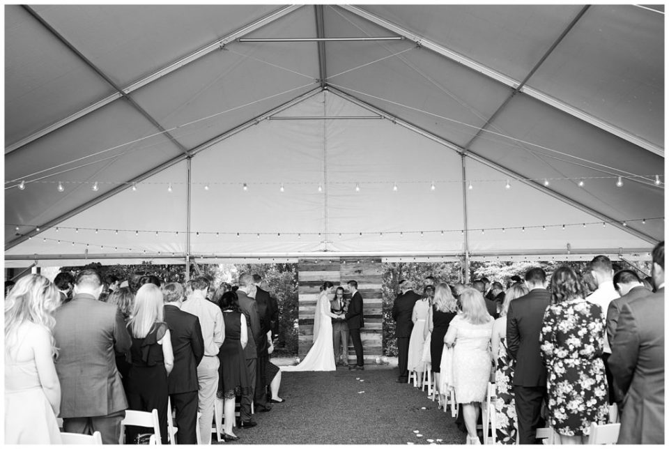 black and white image of tented ceremony at dock 580