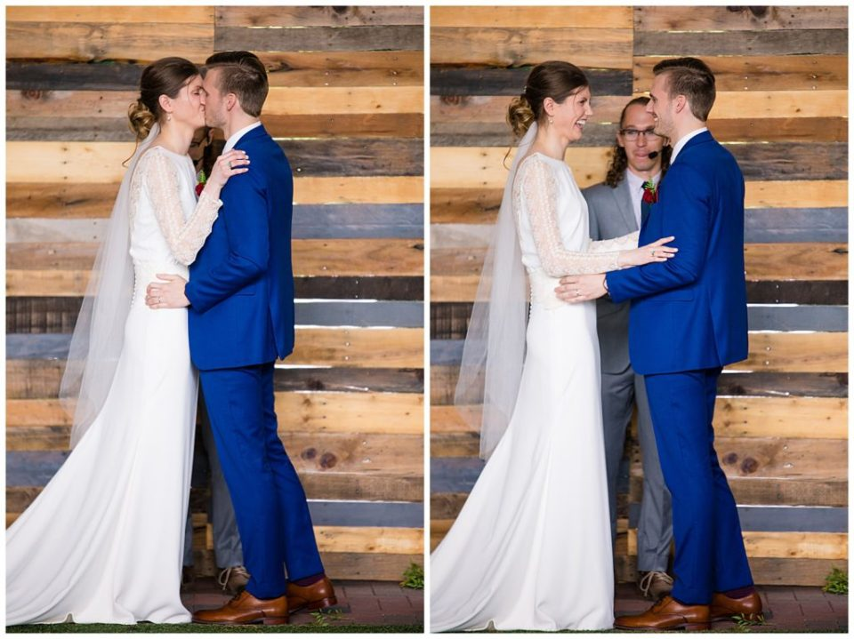 bride and groom share first kiss at dock 580 wedding ceremony