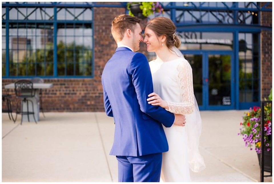 bride and groom about to kiss outside dock 580