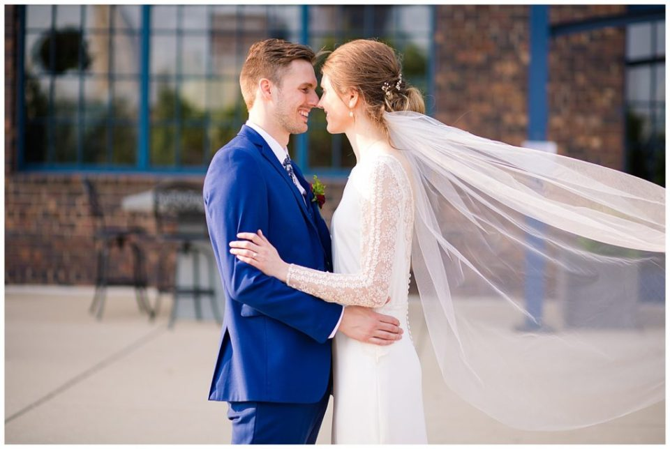 bride and groom during golden hour outside dock 580