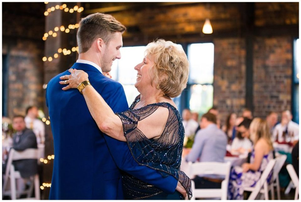 mother and son share first dance at dock 580