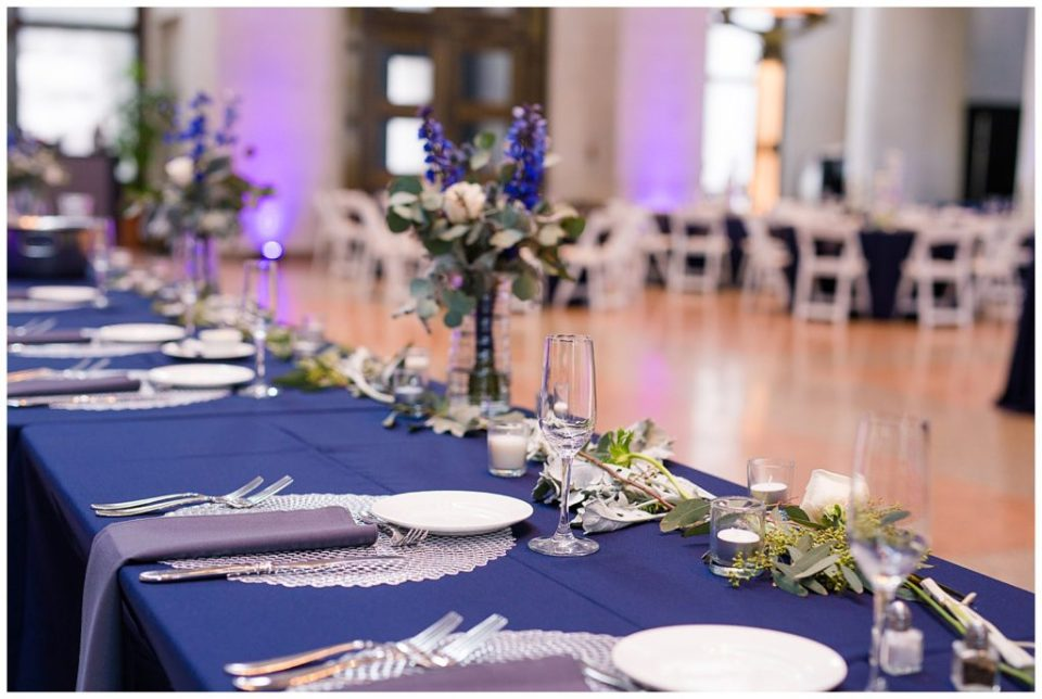 A photograph of a closeup view of the table settings at the head table at the Ohio Statehouse by Alayna Parker  - Columbus OH wedding images