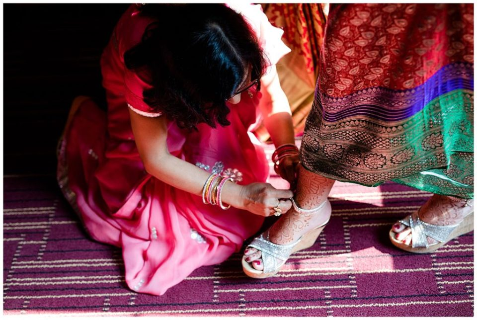 indian bride getting dressed for wedding