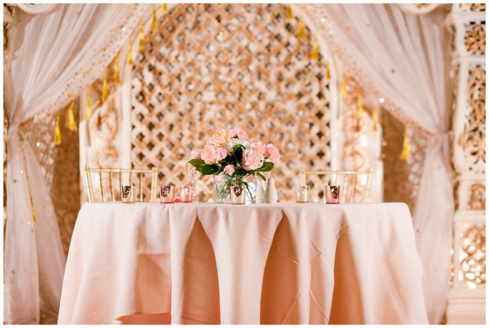pink and white sweetheart table at reception at bertram inn