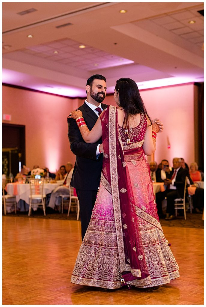 indian bride and groom share first dance at bertram inn