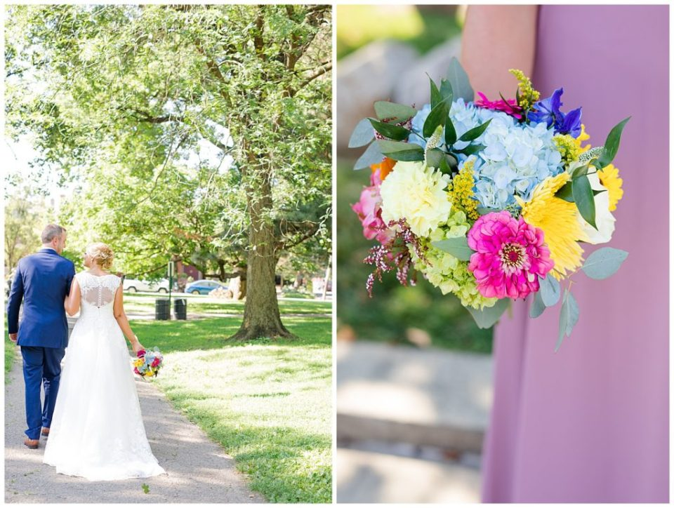 close up of bridesmaid holding colorful bouquet