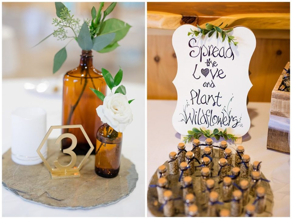 amber glass bottles with white roses and eucalyptus sprigs