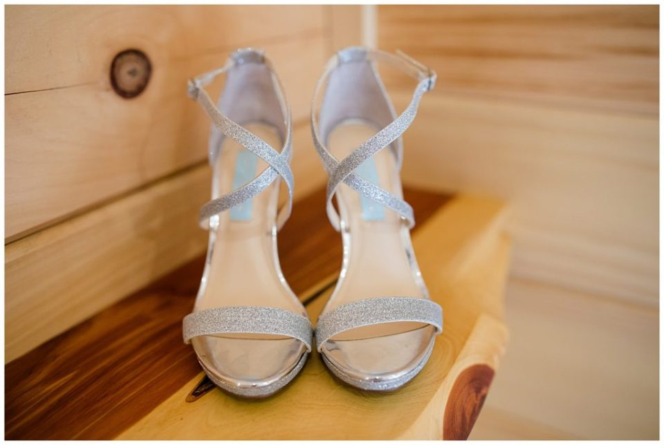 An image of a closeup view of the bride's beautiful silver shoes at the Cedar Grove Lodge venue in Hocking Hills, Ohio by Columbus Ohio wedding photographer, Alayna Parker Photography