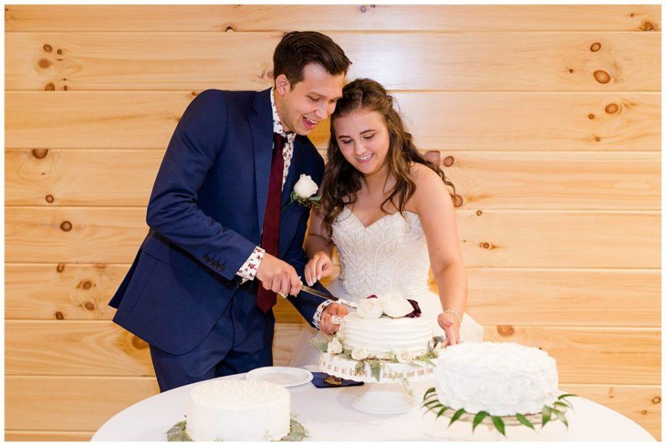 bride and groom cutting cake at cedar grove lodge