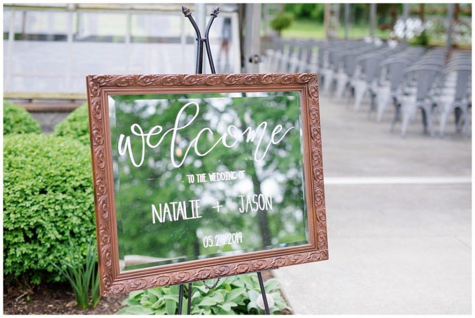 wedding welcome sign written on mirror at jorgensen farms oak grove