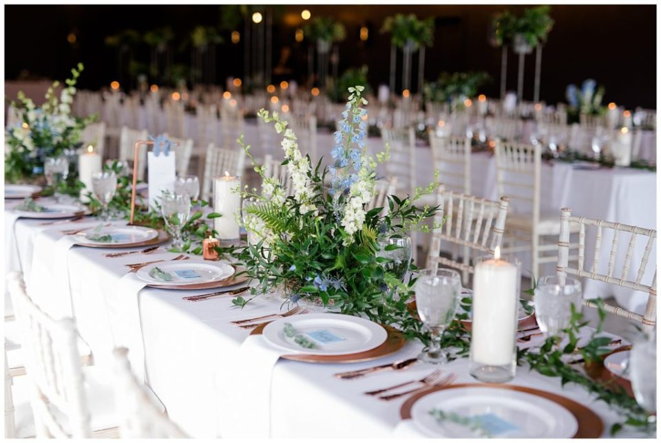 long tables with greenery garlands at jorgensen farms oak grove