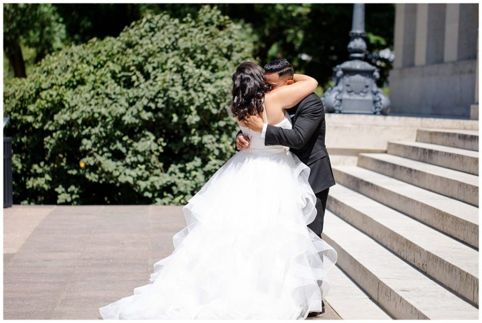 bride and groom hug after first look at ohio statehouse