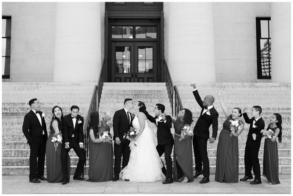 black and white image of bridal party cheering at ohio statehouse