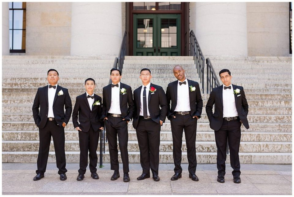 groom and groomsmen standing in front of steps at ohio statehouse