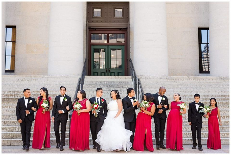 bridal party walking in front of steps at ohio statehouse