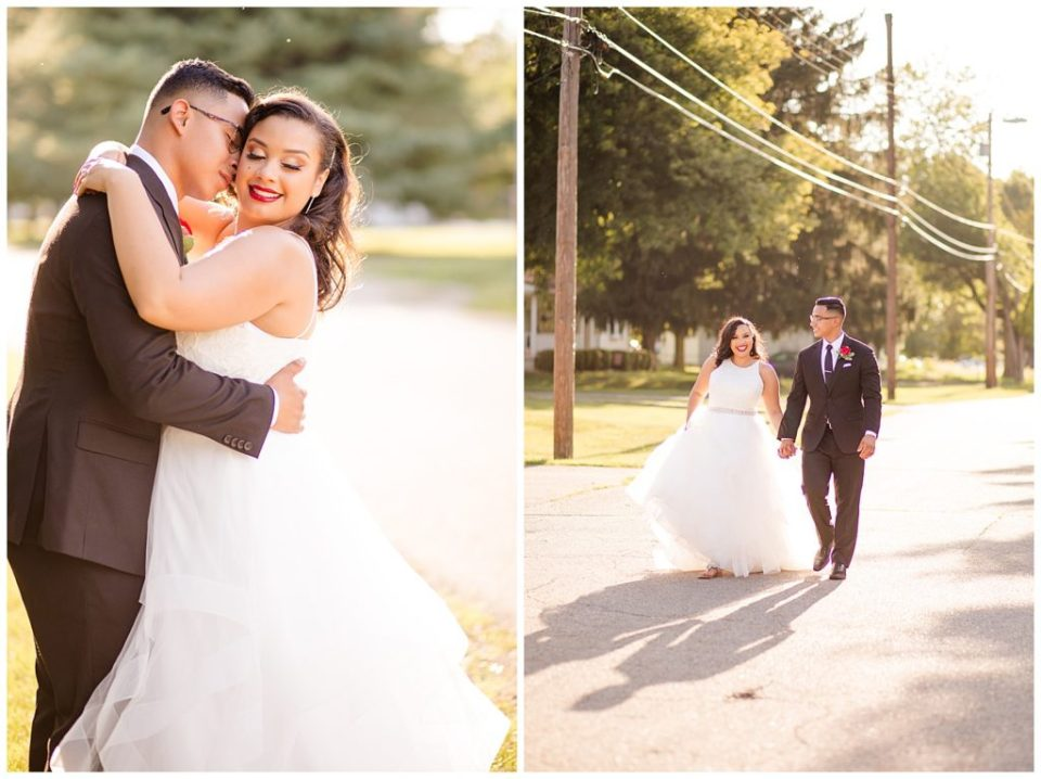 bride and groom walking in street during golden hour at stewart hall in obetz