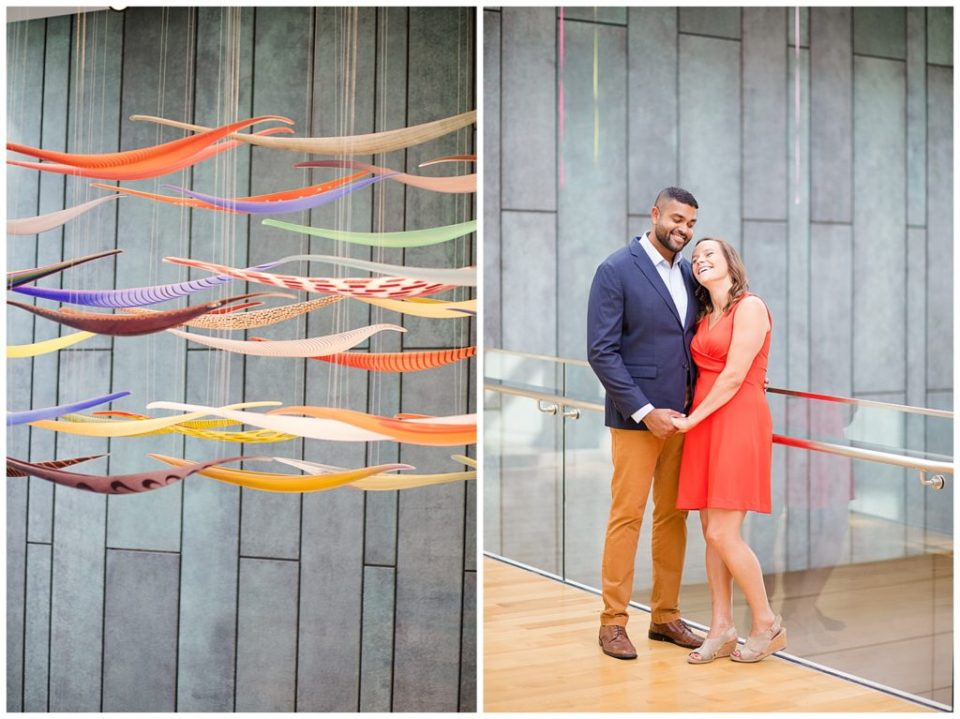 A picture of a colorful floating sculpture in a museum setting, and a view of an engaged couple standing together and smiling happily, holding hands at the Columbus Museum of Art by Alayna Parker  - Columbus  engagement photographer