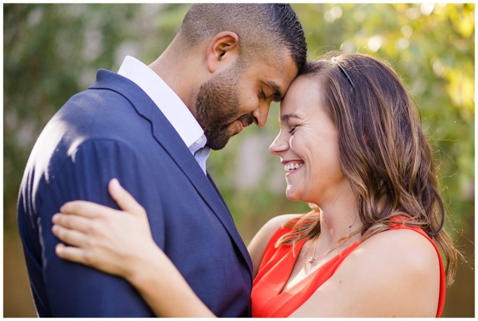 A picture of a closeup view of an engaged couple smiling and holding each other closely as they touch foreheads at the Columbus Franklin Park Conservatory by Alayna Parker Photography Columbus  engagement photography