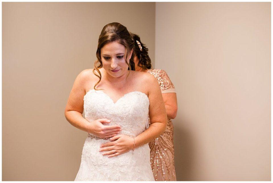 bride getting wedding dress on at station 67