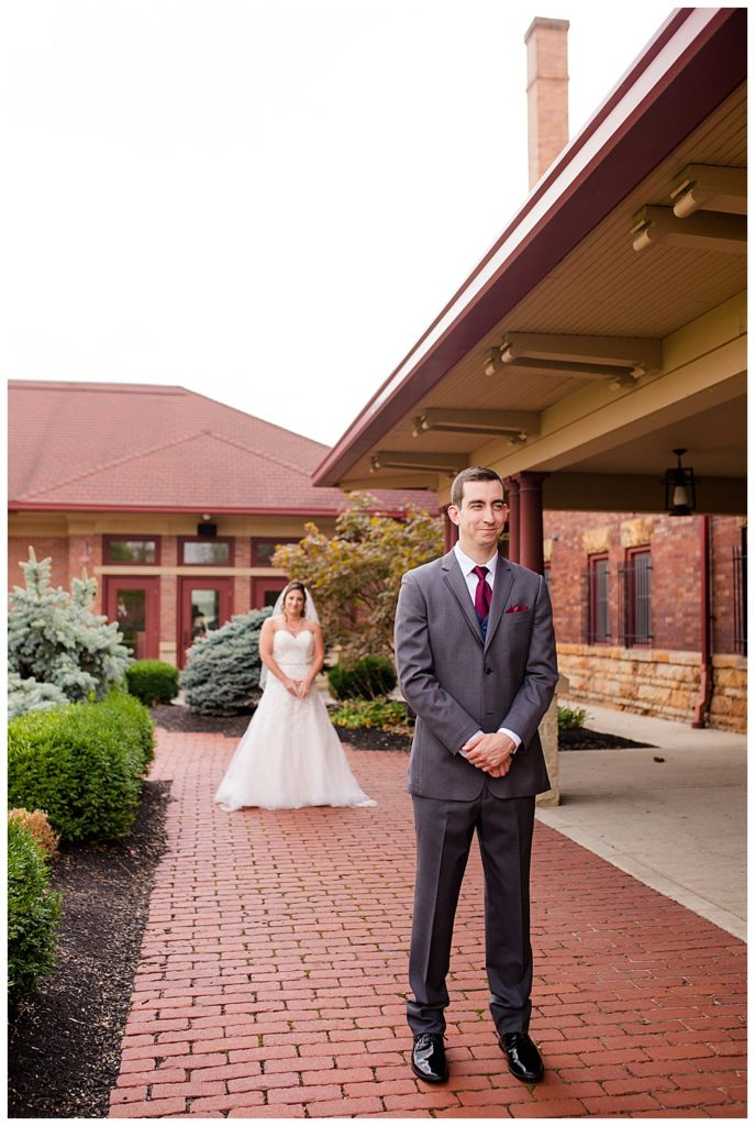 bride standing behind groom before he turns around at station 67