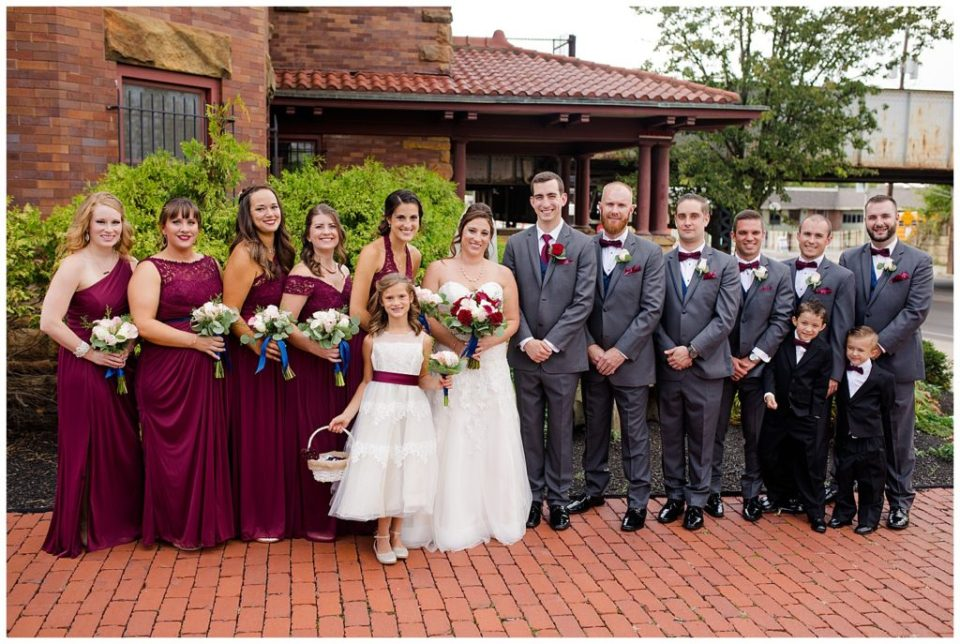 bridal party stand in front of station 67