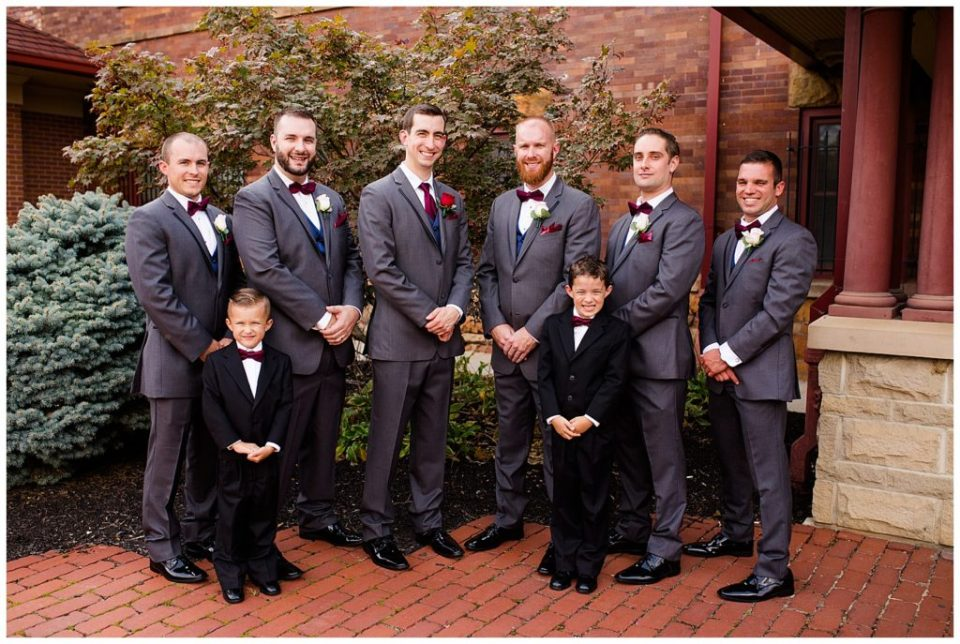 groom and groomsmen stand in front of station 67
