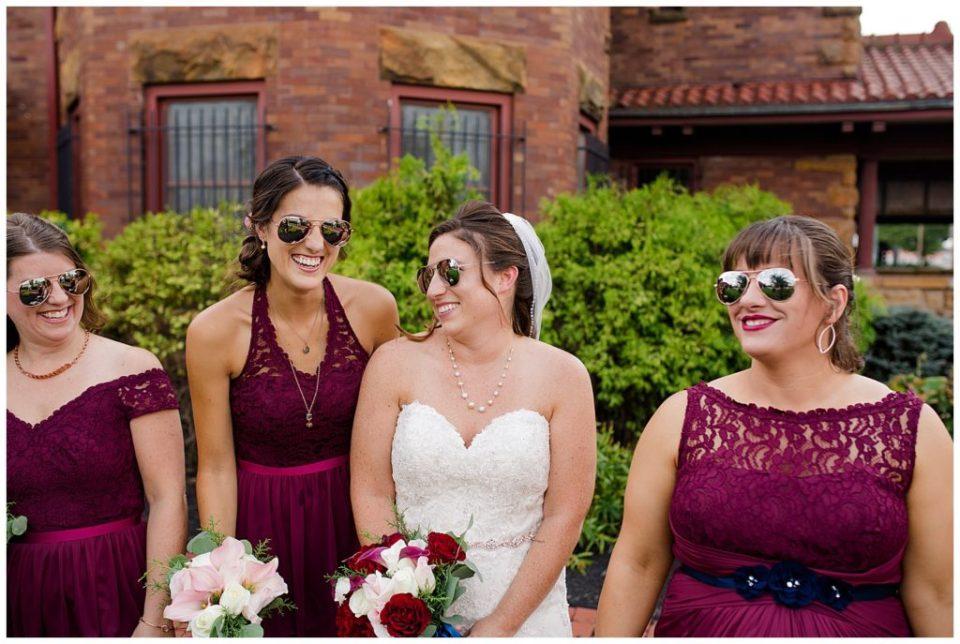bride and bridesmaids walking while wearing sunglasses at station 67