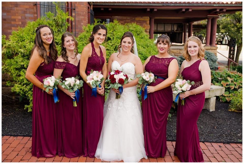 bride and bridesmaids standing in front of station 67