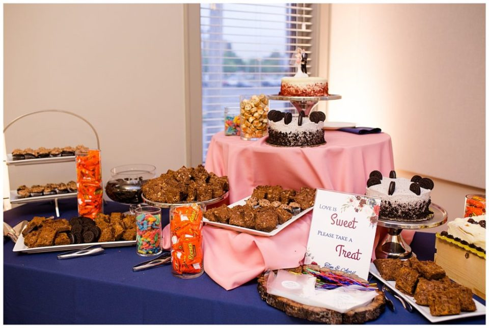 A photograph of the cake table and other goodies for the guests to eat at the reception at a Station 67 Columbus Ohio wedding by Alayna Parker Photography