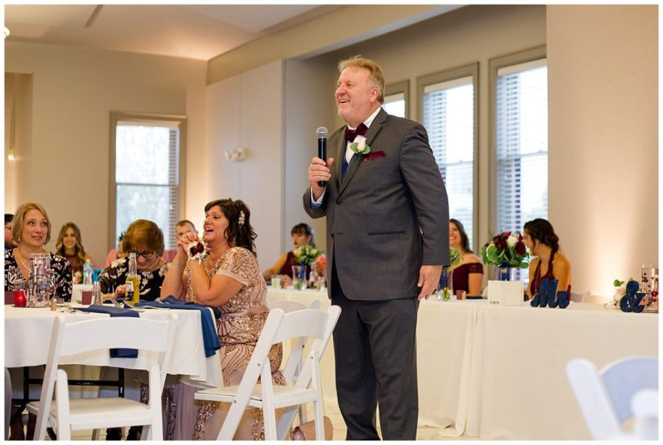 An image of the bride's father standing as he gives his speech at the wedding reception at a Station 67 Columbus  wedding by Alayna Parker Photography